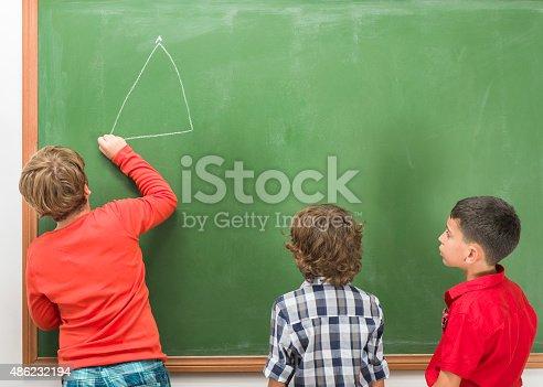 istock Little Boys Studying Geometry On Blackboard 486232194