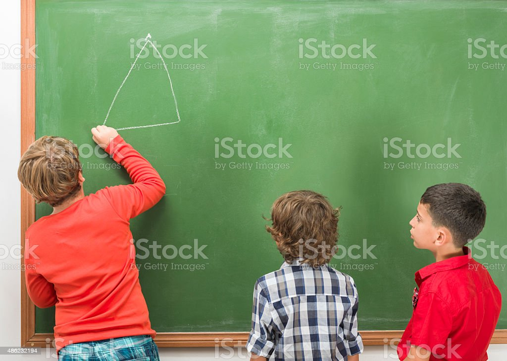Little Boys Studying Geometry On Blackboard stock photo