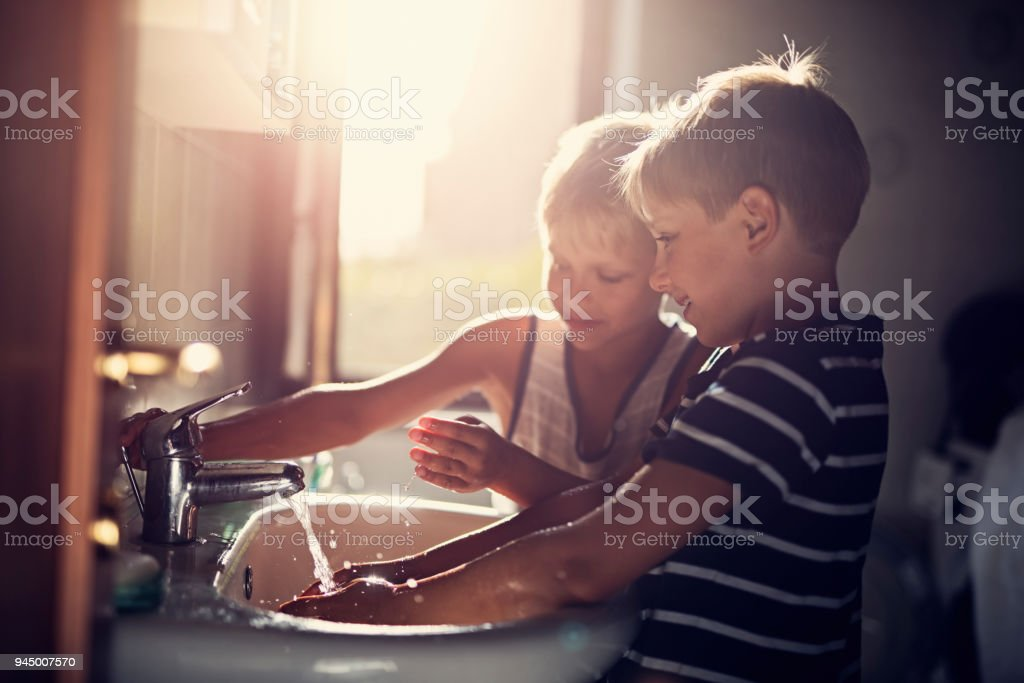 Little boys washing hands stock photo