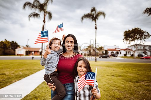 little boys with family celebrate the fourth of july