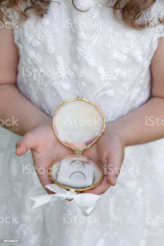 Little bridesmaid with wedding rings zbiór zdjęć royalty-free