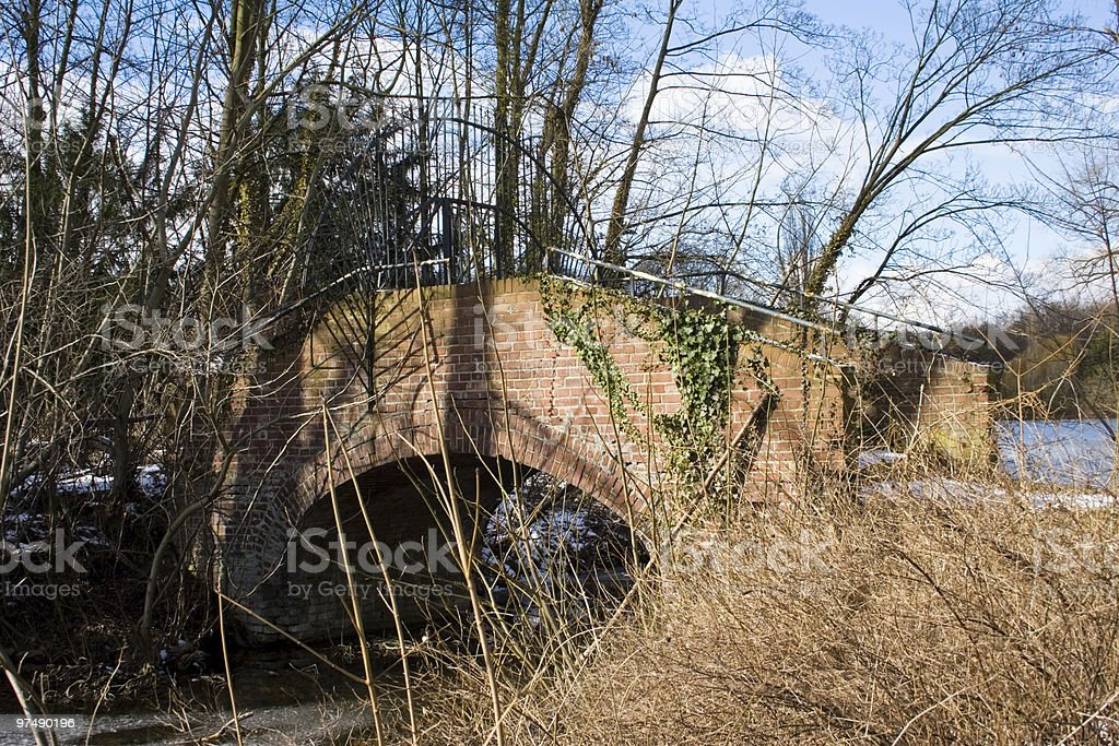 Little bridge in a park with snow royalty-free stock photo