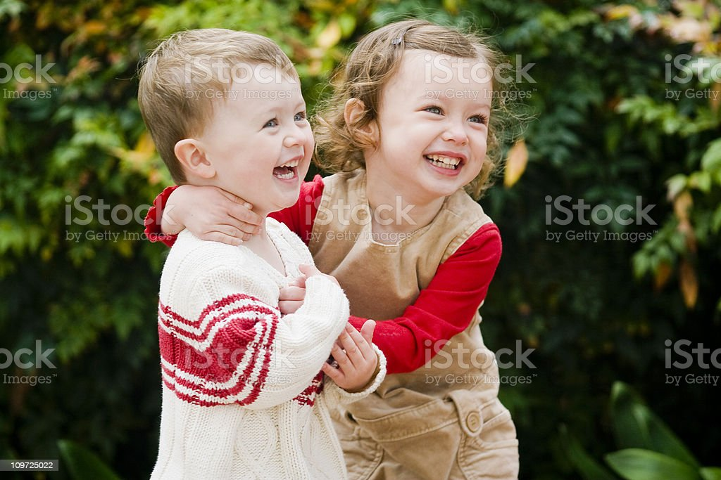 Little Brother with His Sister Laughing and Having Fun royalty-free stock photo