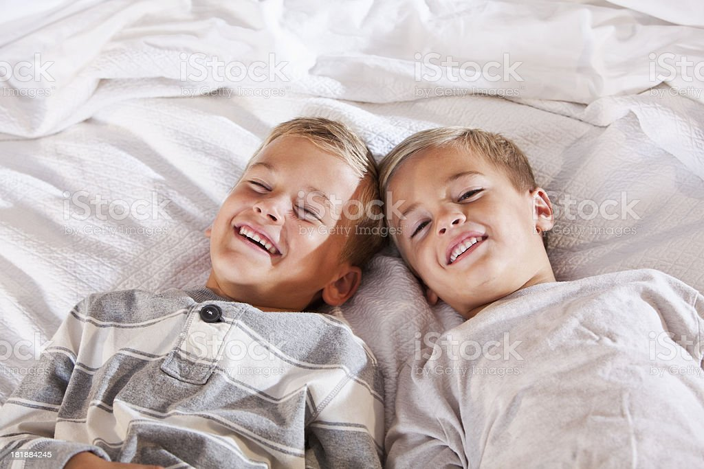 Little brothers lying down, smiling stock photo