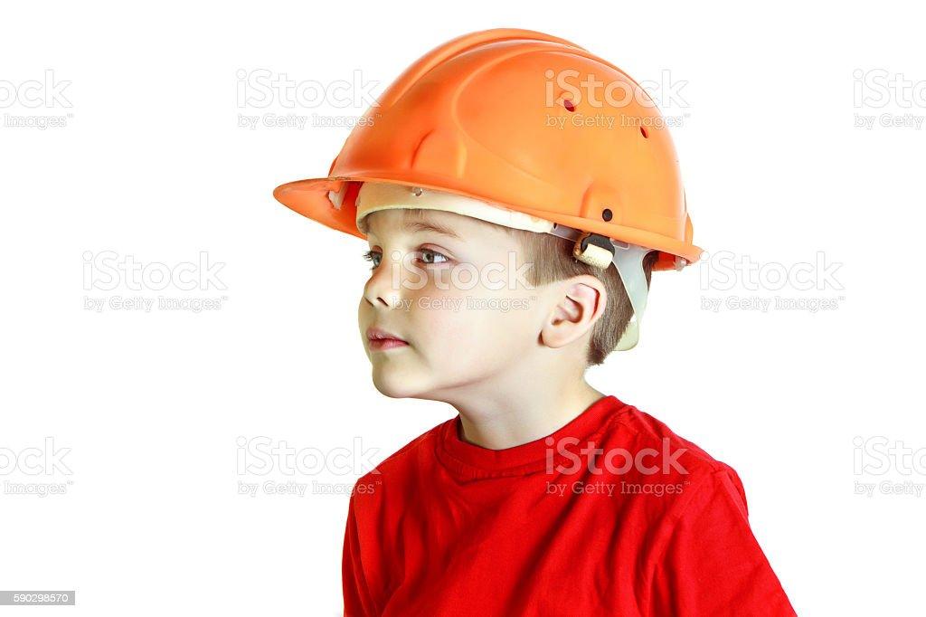 Little builder boy in the construction helmet royaltyfri bildbanksbilder