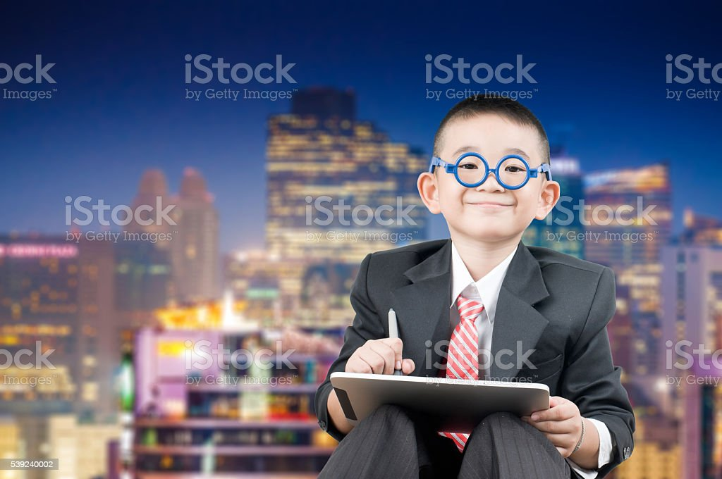 Little bussiness boy with tablet royalty-free stock photo