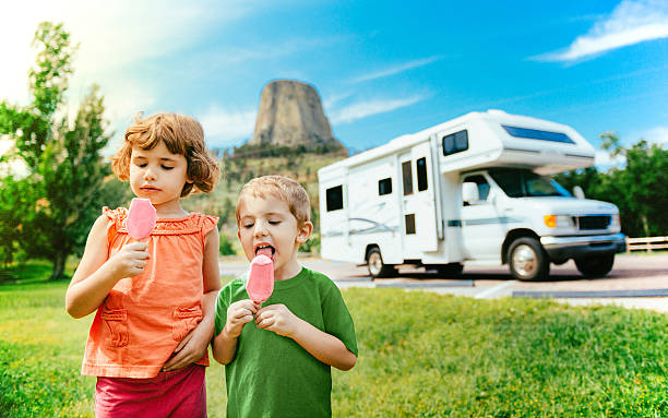 little campers on motorhome road trip - motorhome stock photos and pictures