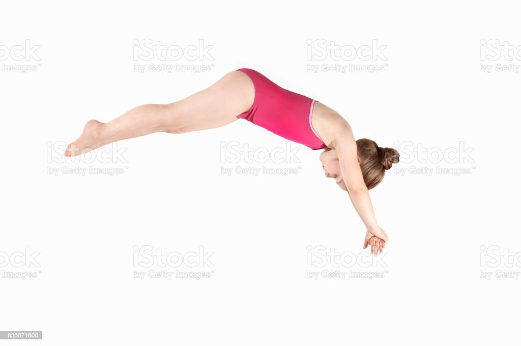 Little caucasian female 6 years old athlete in diver pose stock photo