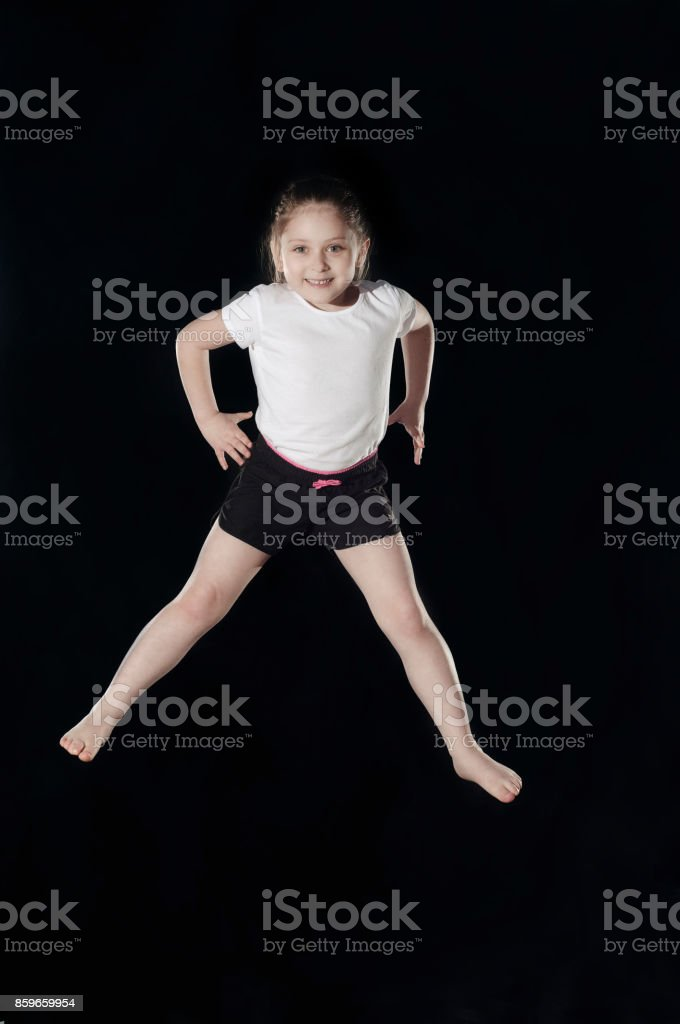 Little caucasian female gymnast stock photo