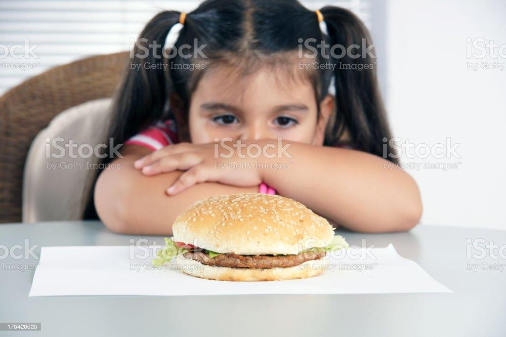 little caucasian girl eating burger (XXXLarge) stock photo