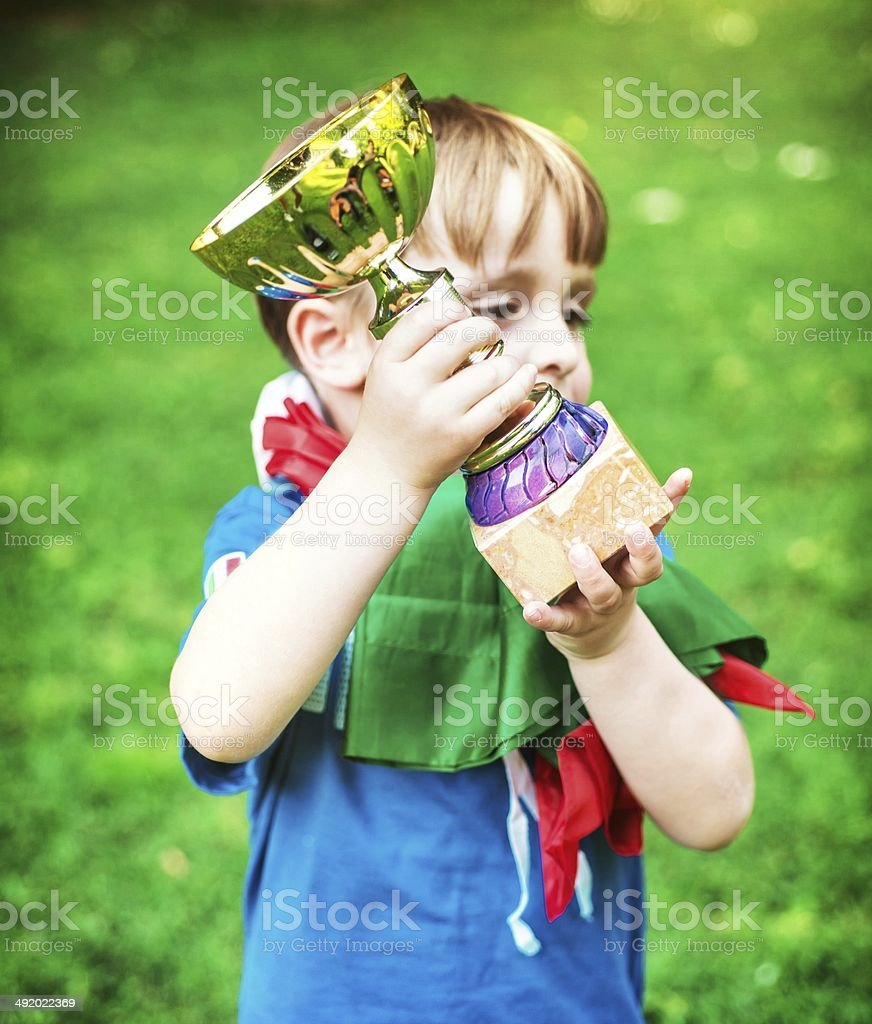 Little Champion with his Trophy stock photo