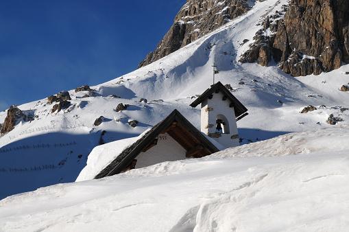 Little Chapel at Passo Falzarego in the Italian Dolomites near Cortina d'Ampezzo. Veneto, Italy.