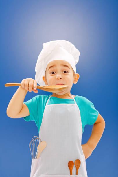 Little chef tasting food