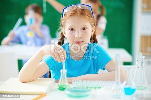 istock Little chemistry student 450804709