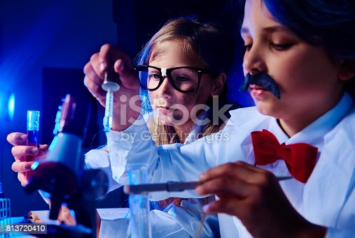 istock Little chemists working about something 813720410