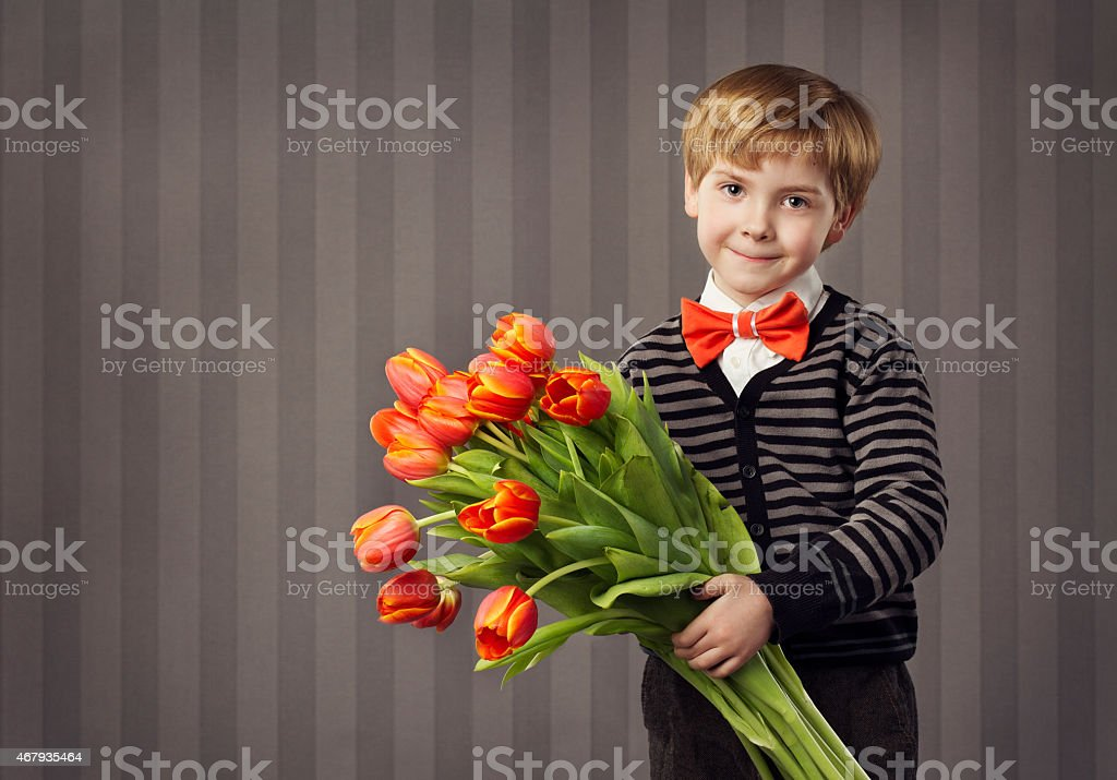 Little Child Boy Flowers Bouquet, Kid Greeting Red Tulips Bunch stock photo
