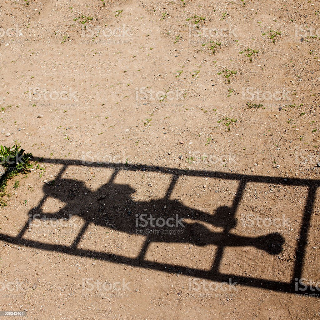 little child climbs on high stairs stock photo