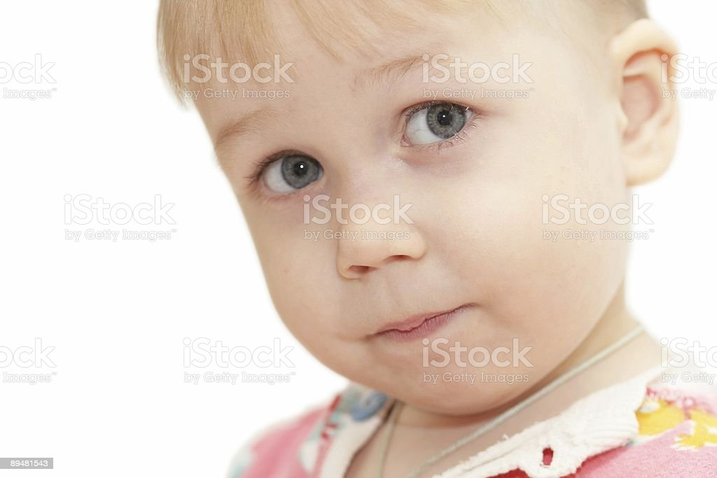 Little child closely looks royalty-free stock photo