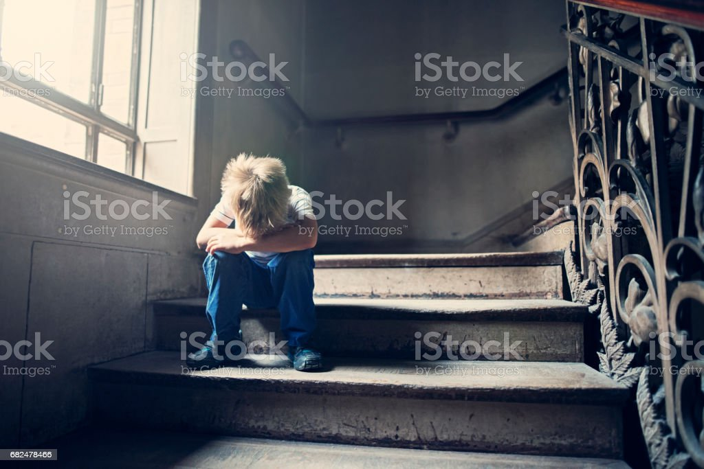 Little child crying on an old staircase royalty-free stock photo