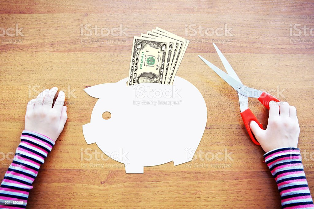 Little child dreaming about savings and wealth Lizenzfreies stock-foto