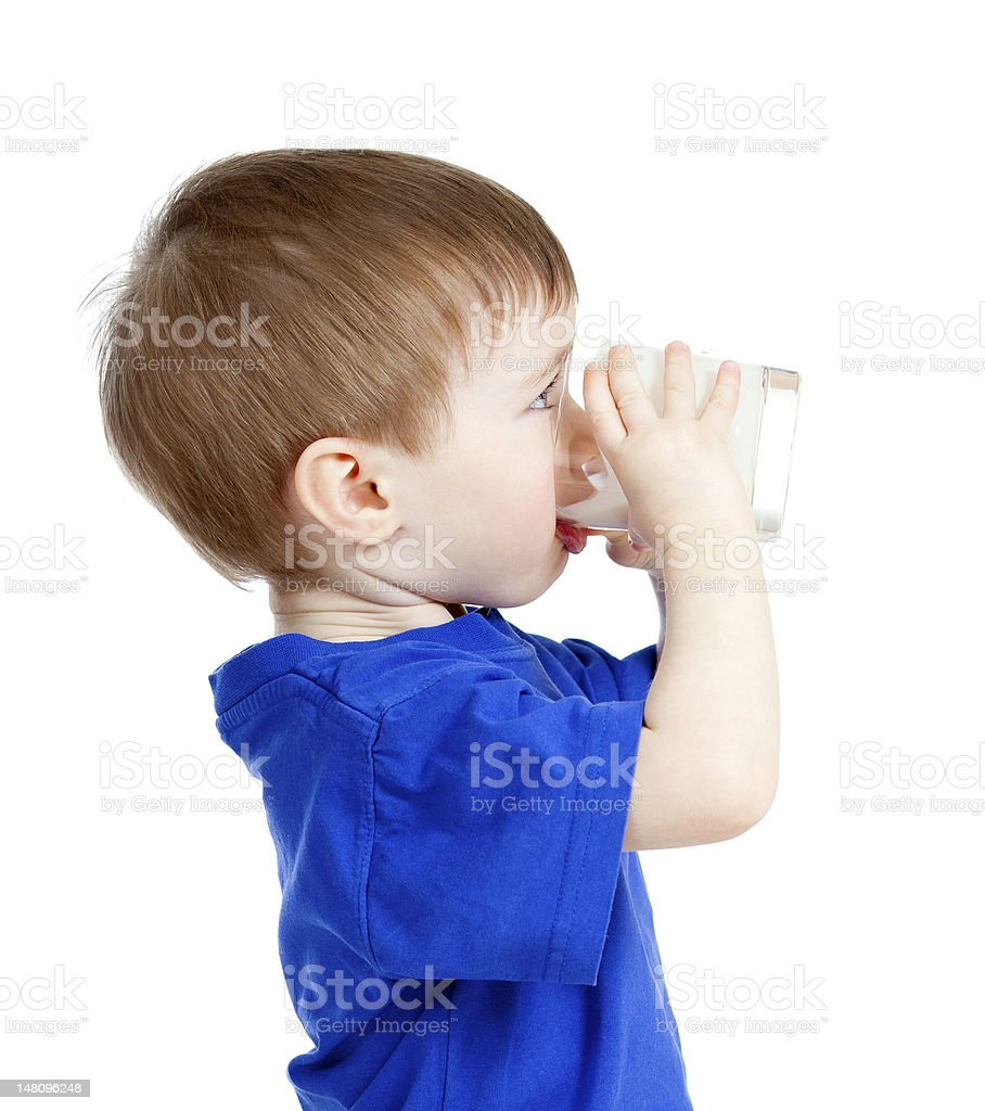 little child drinking yogurt or kefir over white background royalty-free stock photo