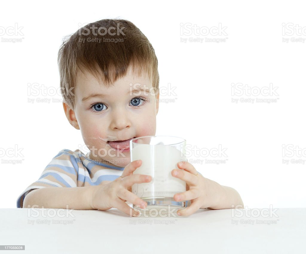 little child drinking yogurt or kefir over white background stock photo