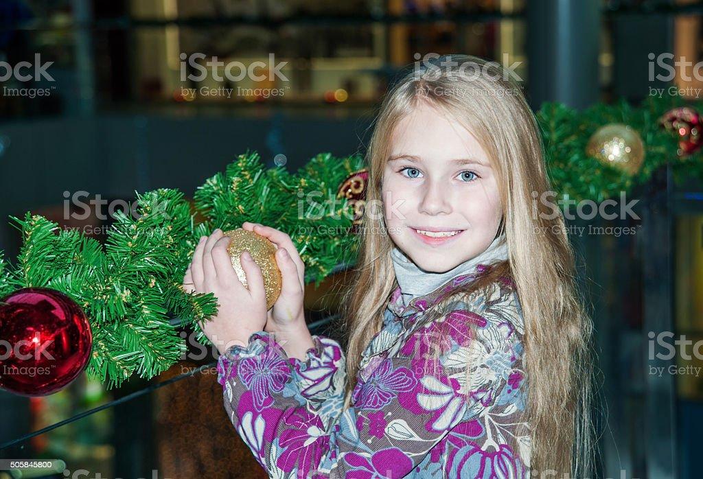Little child girl near Christmas tree. stock photo