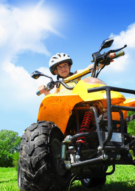 Little Child girl rides on quad off-road stock photo