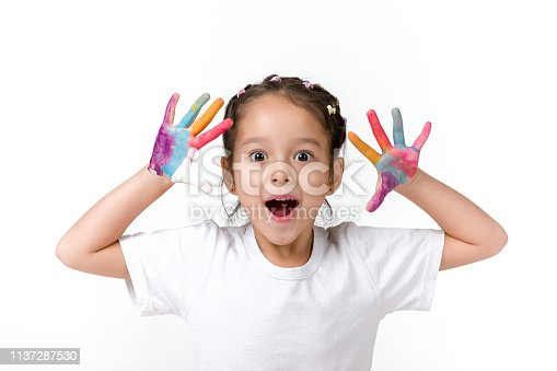 istock little child girl with hands painted in colorful paint 1137287530