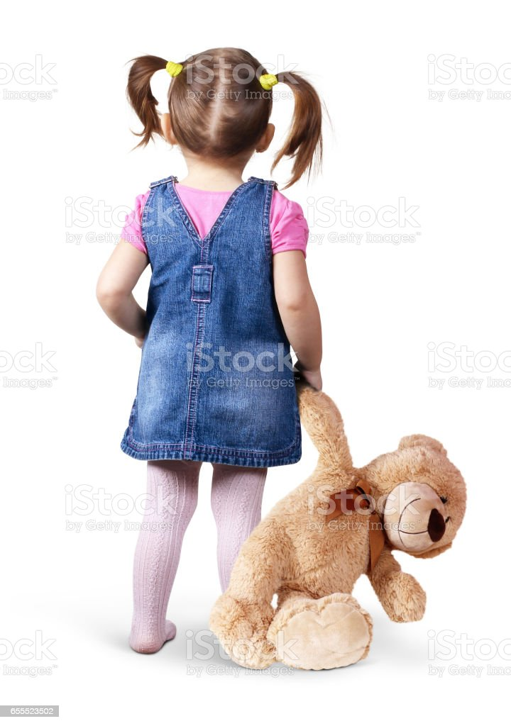 Little child girl with toy bear on white, back view stock photo