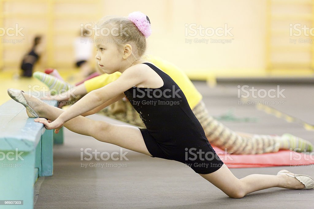 Little child gymnast doing exercise royalty-free stock photo