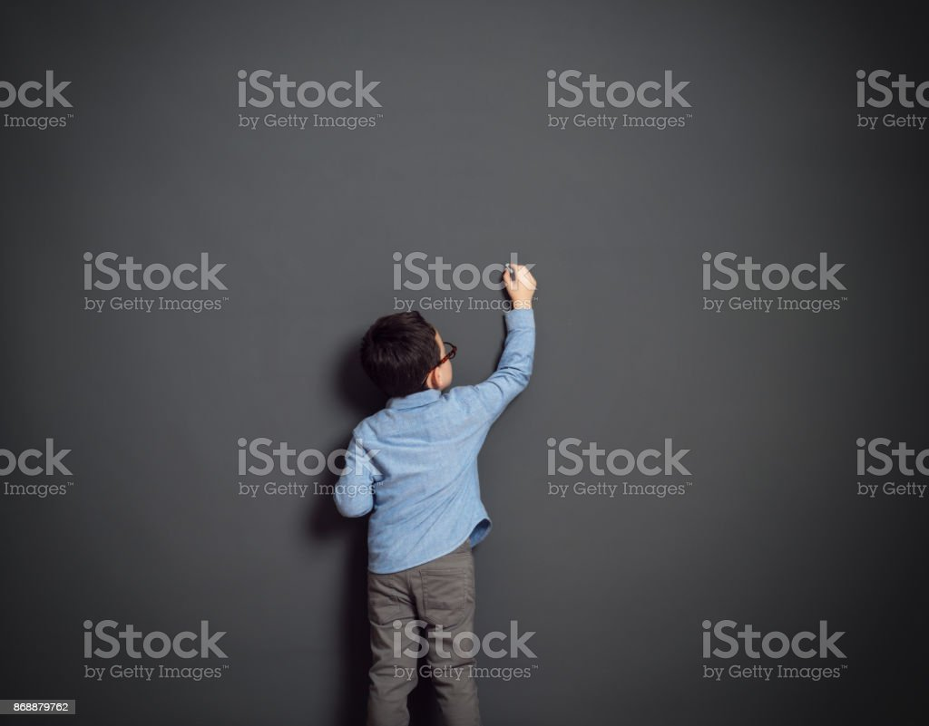 Little child in front of dark background stock photo