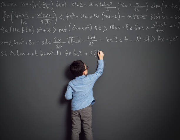 little child in front of huge blackboard - genius stock photos and pictures