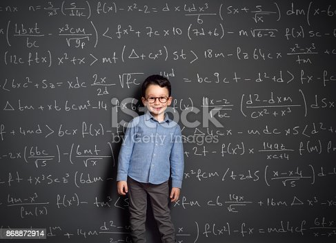 161754253istockphoto Little child in front of huge blackboard 868872914
