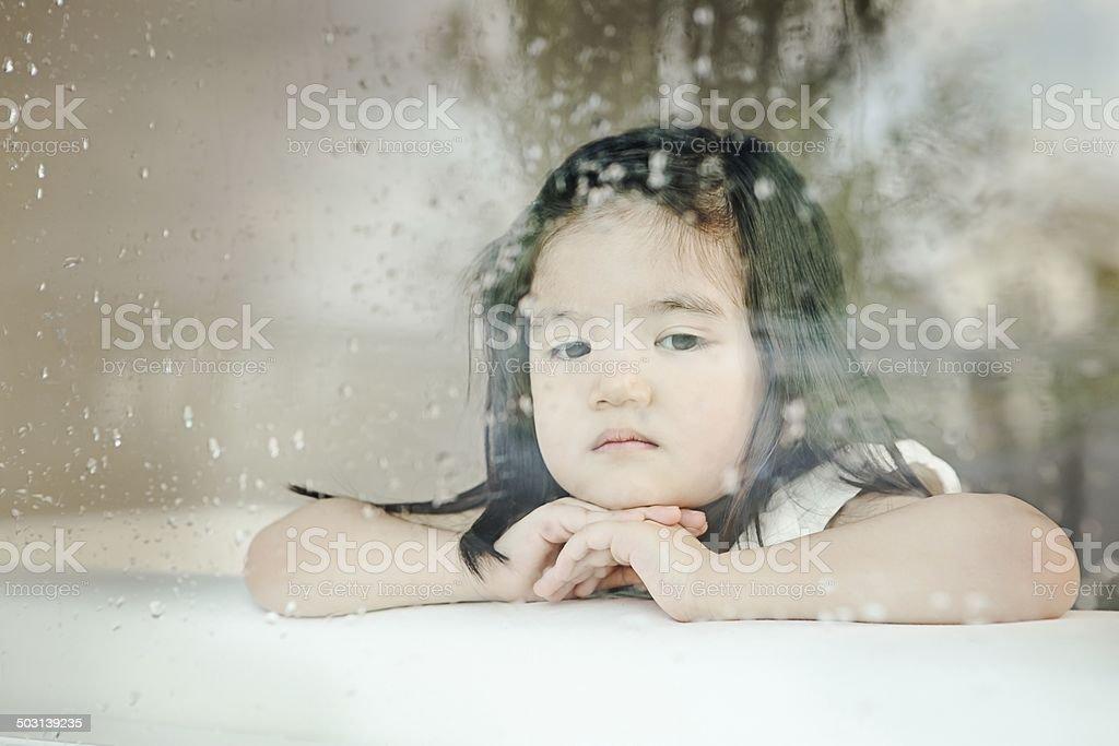 child looking through window. little child looking through window. stock photo window l