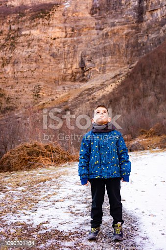 istock Little child on the middle of a rocky mountains 1090201134
