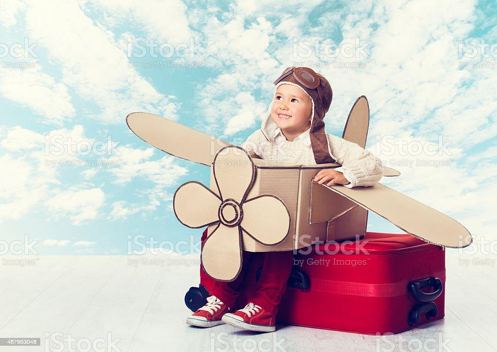 Little Child Playing Airplane Pilot, Kid Traveler on Travel Suitcase stock photo