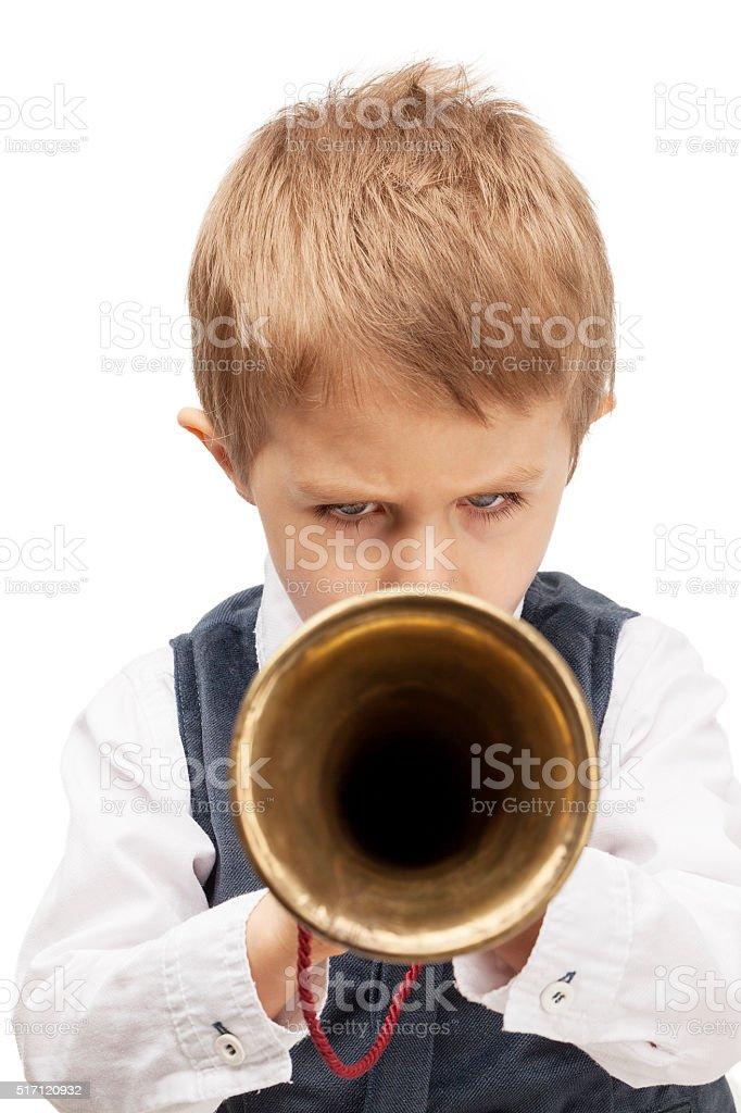 Little child playing bugle stock photo