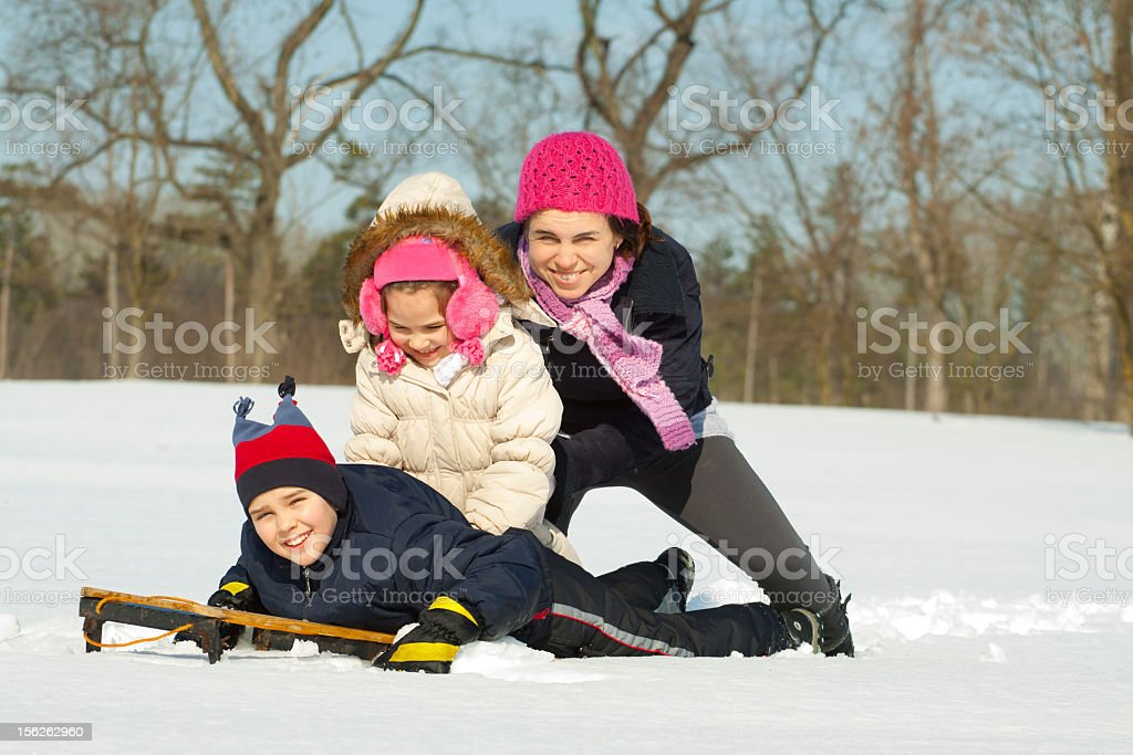 Little child playing in snow royalty-free stock photo