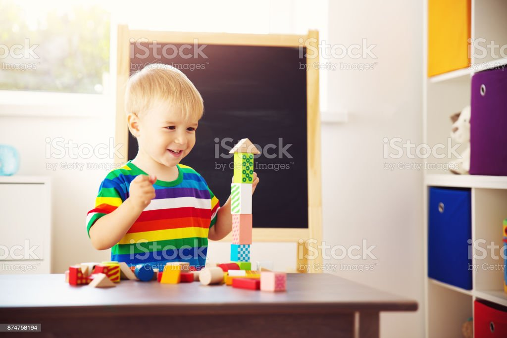 Little child playing with blocks stock photo