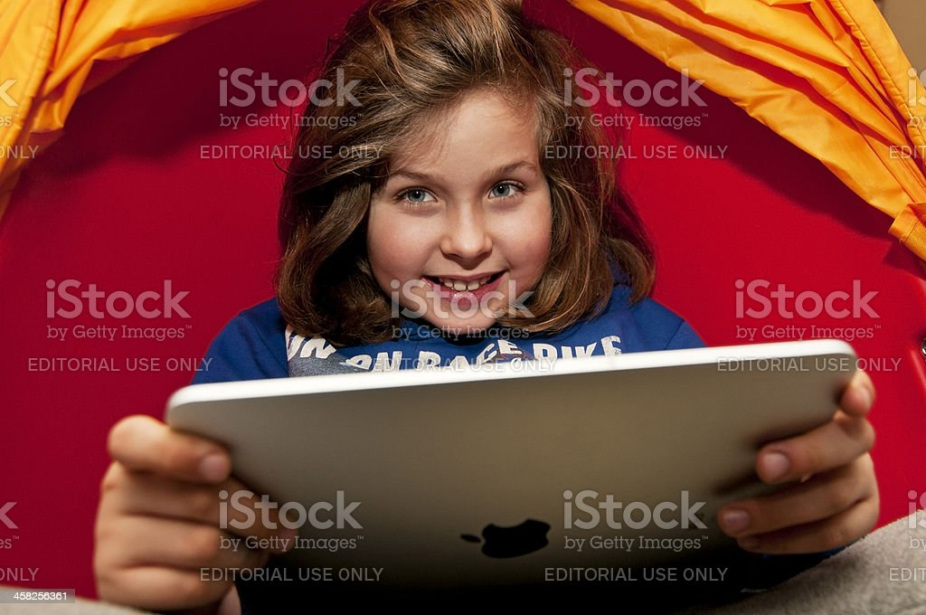 Little child playing with iPad royalty-free stock photo