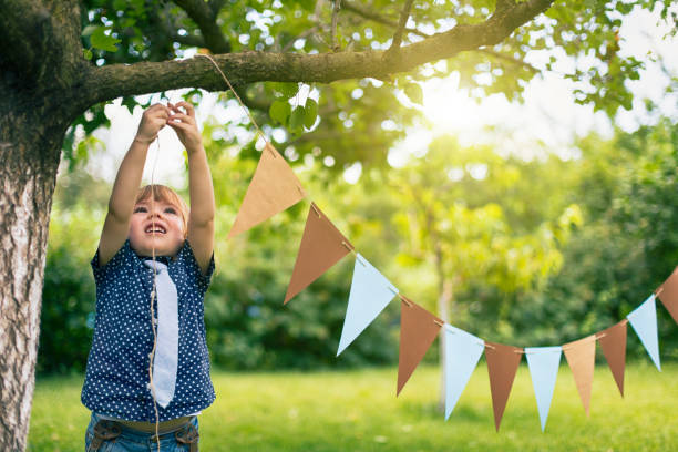 Little child preparing a party event stock photo