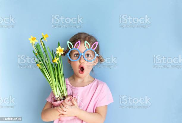 Little child wearing bunny ears glasses and holding flowers on easter picture id1135967514?b=1&k=6&m=1135967514&s=612x612&h=f8nirsvvk7mapyse y8cz6xaq9 1pag4ejo48ec5qe4=
