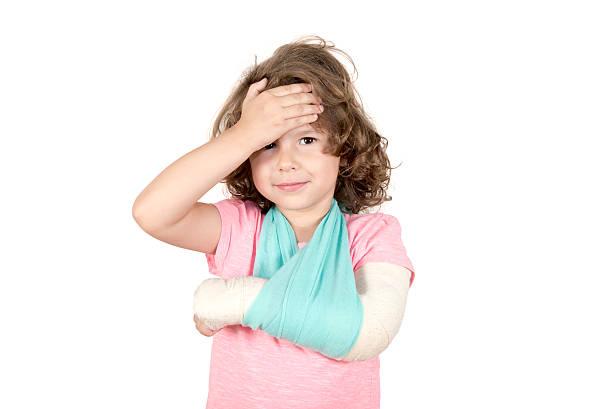 Little child with broken hand stock photo