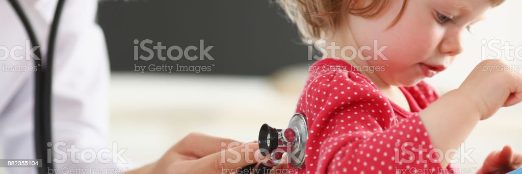 Little child with smarthone at doctor stock photo