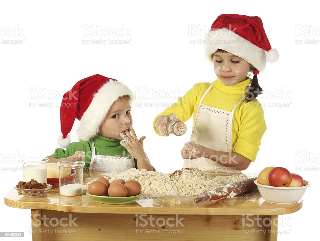 Little children cooking the Christmas cake royalty-free stock photo