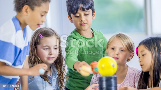 istock Little Children Exploring a Model Solar System 481115060