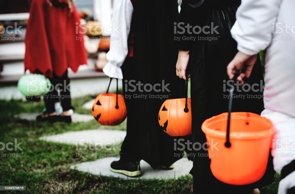 Little children in Halloween costumes stock photo