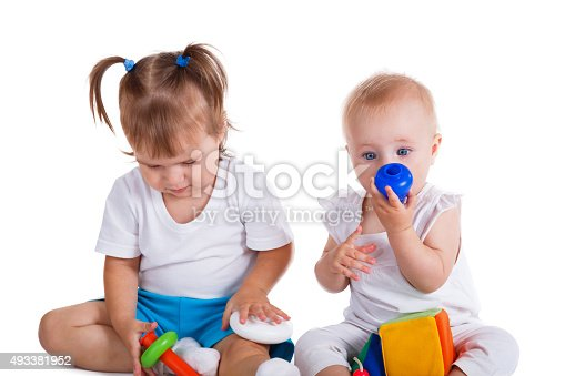 istock Little children playing with toys 493381952