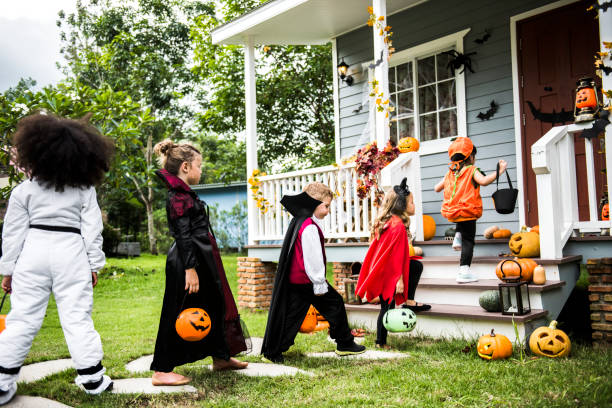 Little children trick or treating Little children trick or treating trick or treat stock pictures, royalty-free photos & images
